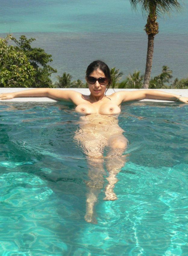 working wife enjoying nude sunbathing during business trip 003
