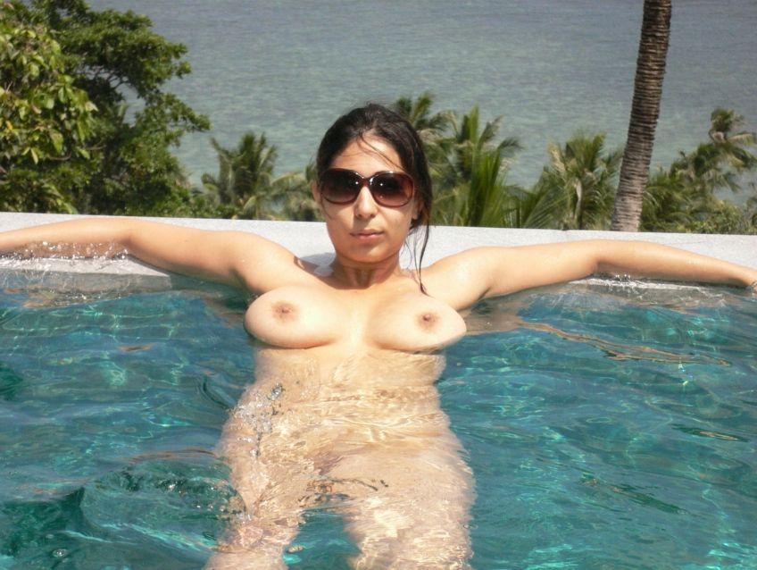 working wife enjoying nude sunbathing during business trip 004